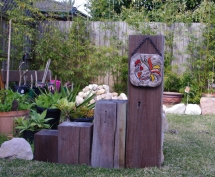 Recycled Posts garden feature - jeans house